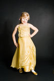 Portret of little girl. In yellow dress royalty free stock image
