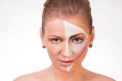 Portret młoda dziewczyna z farbą na jej twarzy Fotografia Stock