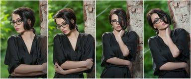 Portret młoda kobieta w czarnej jedwabniczej opatrunkowej todze, opiera przeciw ścianie Piękna uwodzicielska z włosami kobieta, p obraz royalty free
