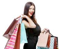 Portret młoda szczęśliwa uśmiechnięta kobieta z torba na zakupy Obrazy Royalty Free
