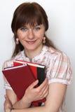 Portret młody śliczny uczeń z podręcznikami wewnątrz Zdjęcia Stock