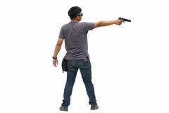 Portret młody człowiek z pistoletem na białym tle Fotografia Stock