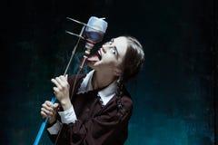 Portret młoda dziewczyna w mundurku szkolnym jako wampir kobieta Obraz Royalty Free