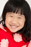 Portret Mała azjatykcia dziewczyna z uśmiechami stawia czoło Obrazy Stock