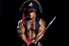 Portret mięśniowy mężczyzna w pirata kostiumu Obraz Stock