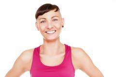 Portret odizolowywający nad białym tłem sprawności fizycznej kobieta Smilin zdjęcie stock