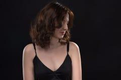 Portret patrzeć w dół młodej brunetki kobiety Zdjęcia Royalty Free