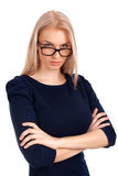 Młoda kobieta patrzeje ciebie nad szkłami Zdjęcie Stock