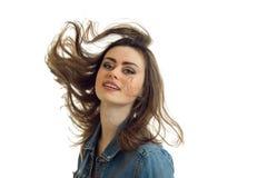 Portret piękna młoda brunetka które latają oddalonego włosy downwind na białym tle Obraz Royalty Free