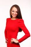 Piękna młoda kobieta w czerwieni sukni Zdjęcia Royalty Free