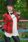 Portret piękna młoda kobieta w horsewoman kostiumu w lesie Zdjęcia Royalty Free