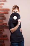 Portret piękna dziewczyna z winylowym dyskiem Zdjęcie Royalty Free