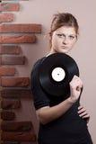 Portret piękna dziewczyna z winylowym dyskiem Zdjęcie Stock