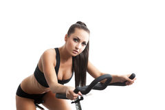 Portret pozuje na rowerze seksowna młoda kobieta Obrazy Royalty Free