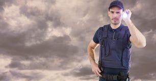 Portret pracownika ochrony mienia latarka przeciw chmurnemu niebu Zdjęcie Royalty Free