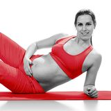 Portret of pregnant woman in sportswear, isolated on white Royalty Free Stock Photography