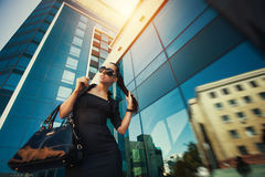 Portret of pretty woman in the city Stock Photos