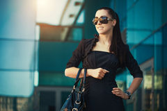 Portret of pretty woman in the city Stock Photography