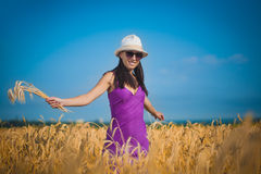 Portret of pretty woman on the yellow  field Stock Image