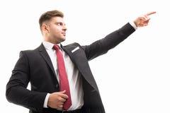 Portret przystojny korporacyjny biznesowy mężczyzna wskazuje up zdjęcia stock