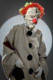 Portret smutny błazen z czerwonym nosem Fotografia Royalty Free