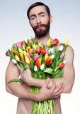 Portret smutny mężczyzna z kwiatami Zdjęcie Royalty Free