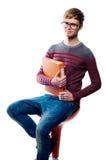 Portret studencki obsiadanie na krześle Obraz Royalty Free