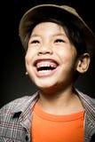 Portret Szczęśliwa azjatykcia śliczna chłopiec z uśmiech twarzą Fotografia Stock
