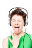 Portret szczęśliwa dziewczyna kocha hard rock z hełmofonami fotografia royalty free
