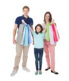 Portret szczęśliwa rodzina z torba na zakupy zdjęcie stock