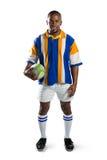 Portret szczęśliwa rugby gracza mienia piłka obraz stock