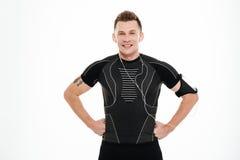Portret szczęśliwa uśmiechnięta mężczyzna atleta w słuchawek stać Fotografia Royalty Free