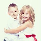 Portret szczęśliwe chłopiec i dziewczyny Zdjęcie Stock