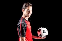 Portret szczęśliwy męski atlety mienia futbol Obraz Royalty Free