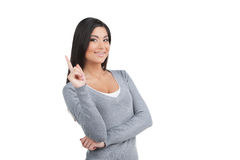 Portret uśmiechnięta ufna kobieta z palcem up. fotografia stock