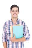 Portret uśmiechnięte męskie studenta collegu mienia książki Zdjęcia Royalty Free