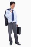 Portret uśmiechnięty biznesmen trzyma teczkę i jego ja Obraz Stock