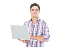 Portret uśmiechnięty męski uczeń używa laptop Fotografia Royalty Free