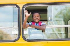 Portret uczniowska falowanie ręka od autobusu Zdjęcia Stock