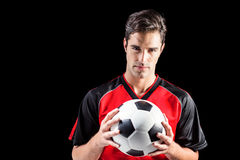 Portret ufny męski atlety mienia futbol Obraz Royalty Free