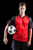 Portret ufny męski atlety mienia futbol Obrazy Stock