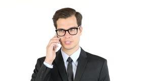 Portret ufny przystojny biznesmena mówienie na smartphone Zdjęcia Stock
