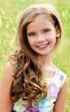 Portret uroczy uśmiechnięty małej dziewczynki dziecko w smokingowy plenerowym obraz royalty free