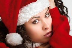 Portret uwodzicielska kędzierzawa Santa dziewczyna Fotografia Stock