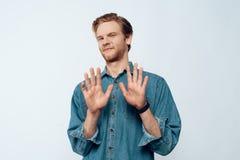 Portret van Aantrekkelijke Jonge Mensenhanden omhoog stock foto