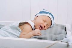 portret van baby van de slaap de onschuldige zuigeling stock afbeeldingen