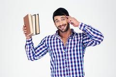 Portret van boeken van een de vrolijke jonge mensenholding Stock Foto's