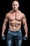 Portret van de domoren van de bodybuilderholding Royalty-vrije Stock Afbeelding