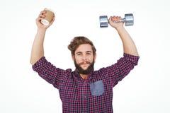 Portret van de domoren van de hipsterholding en beschikbare kop Royalty-vrije Stock Foto