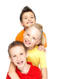 Portret van de gelukkige die kinderen op wit worden geïsoleerdi Stock Foto